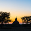 silhouetted temple at sunset in Bagan, Myanmar