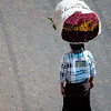 Burmese carrying flowers