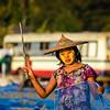 Burmese woman drying fresh fish