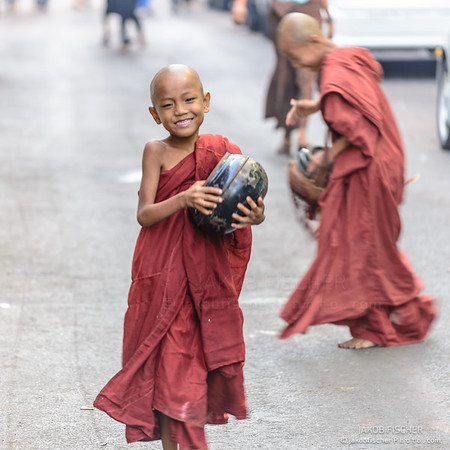 Young monk asking for alimenation