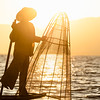 Leg rowing burmese fisherman at Inle Lake