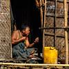Burmese shaving his beard