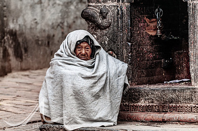 An elderly man outside a temple in Dattatreya Square, Bhaktapur, Nepal.