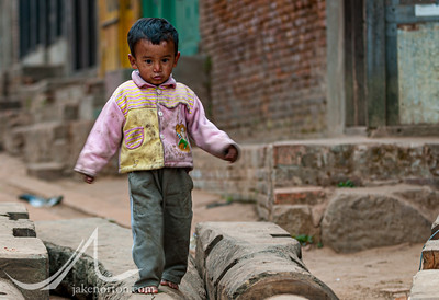 A young boy walks on parts of the Bisket Jatra chariot disassembled in the streets of Bhaktapur, Nepal.