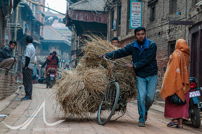 Early morning street scene in Bhaktapur (also known as Bhadgaon or Khwopa), a largely traditional, ancient city in Kathmandu, Nepal.
