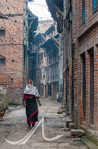 A Newari woman walks down a narrow street in Bhaktapur, Nepal.