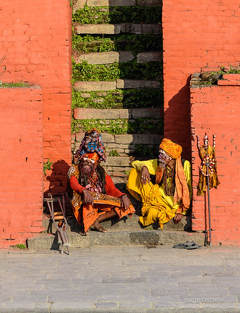 two yogis sitting next to the cremation ghats in Pashupatinath, Kathmandu valley