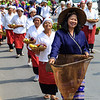 Traditionally dressed women in procession on Chiang Mai 37th Flower Festival parade