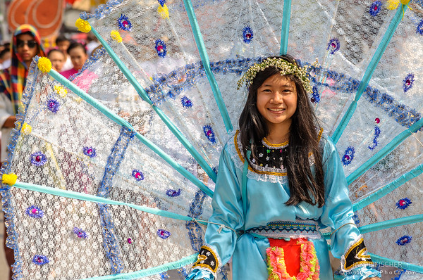 Traditionally dressed woman in procession on Chiang Mai 37th Flower Festival parade
