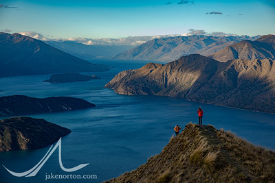 Hikers on Roy's Peak above Lake Wanaka, New Zealand.