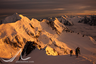 Brent Bishop and Charley Mace climb at sunrise high on the Linda Glacier Route on Aoraki (Mount Cook), New Zealand.