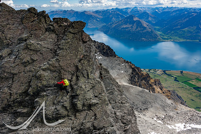 Brent Bishop climbs on the Double Cone Traverse high in the Remarkables, Otago, New Zealand, with Lake Wakatipu behind.