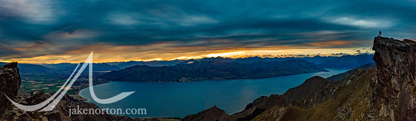 A hiker gazes out across Lake Wanaka, New Zealand.