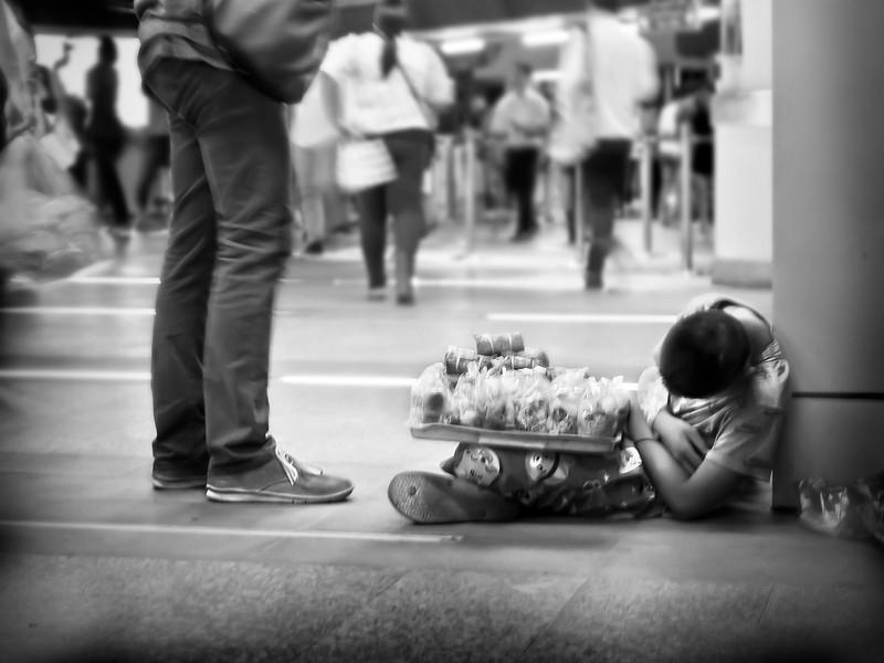 Little boy vendor was so tired