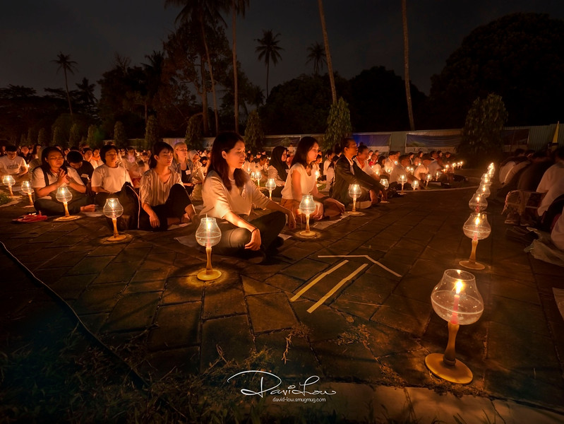 Regardless of religion, devotees and tourists alike, gathered together and meditate before the release of lanterns.