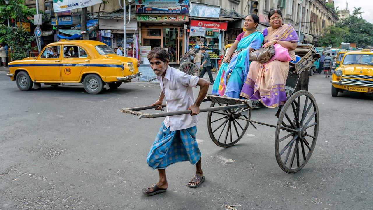 Rickshaw puller in action