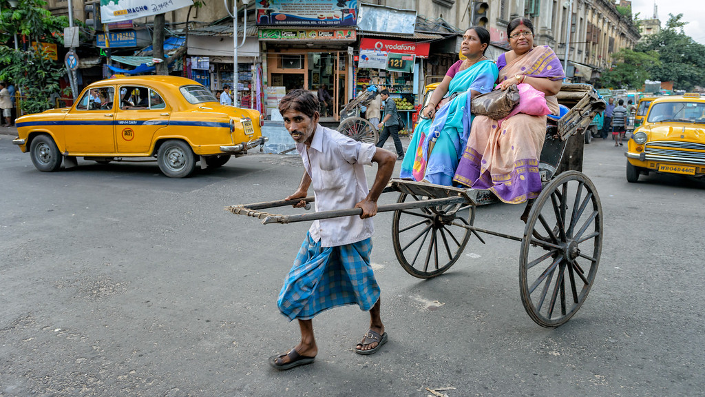 Rickshaw puller in action