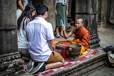 Blessing by a Young Monk at Angkor Wat