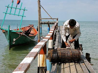 a crab fisherman on Rabbit Island, near Kep