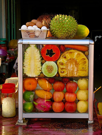 a fruit and juice sellers stand in Kampot