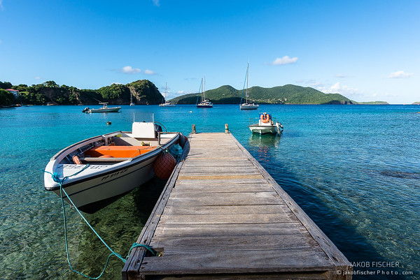 boat on the jetty, crystal clear water