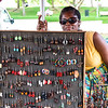 LE GOSIER, GUADELOUPE - OCTOBER 02, 2015: creole lady selling jewelry on a street market