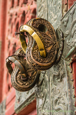 Detail from door of building inside the Forbidden City, Beijing.