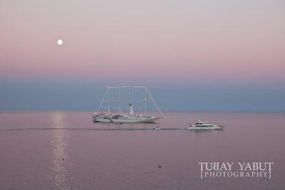 full moon rising over the Mediterranean