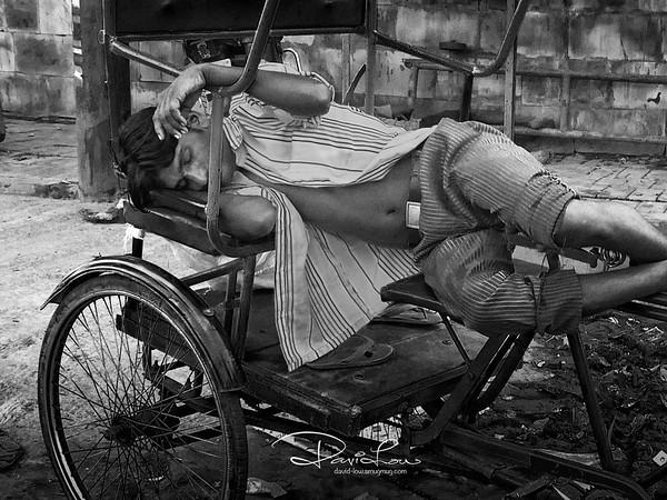 Trishaw puller - when rain was falling