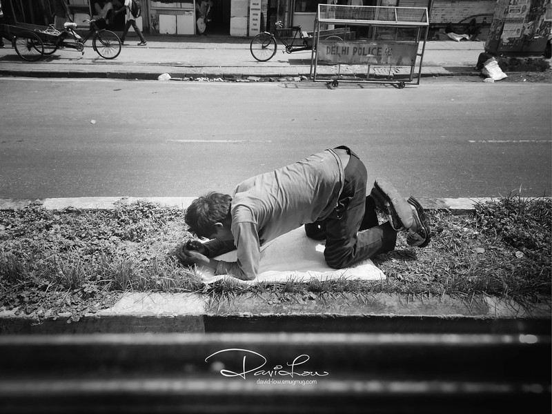 Praying on the road divider