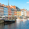 COPENHAGEN, DENMARK - JUL 09, 2017: Nyhavn with colorful houses and sailing boats in Copenhagen, the capital of Denmark