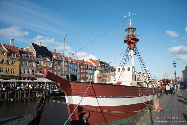 COPENHAGEN, DENMARK - JUL 09, 2017: Nyhavn with colorful houses and sialing boats in the capital of Denmark