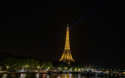 The Eiffel Tower at night above the Seine River from Passerelle Debilly, Paris, France.