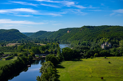 The Dordogne River cutes through the French countryside from Château de Beynac, France.
