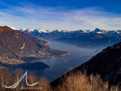 The Alps and Lake Como from the summit of Monte Colmenacco, Lombardy, Italy.