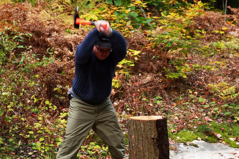 Cadman taking on lumberjack stance - splitting fire wood