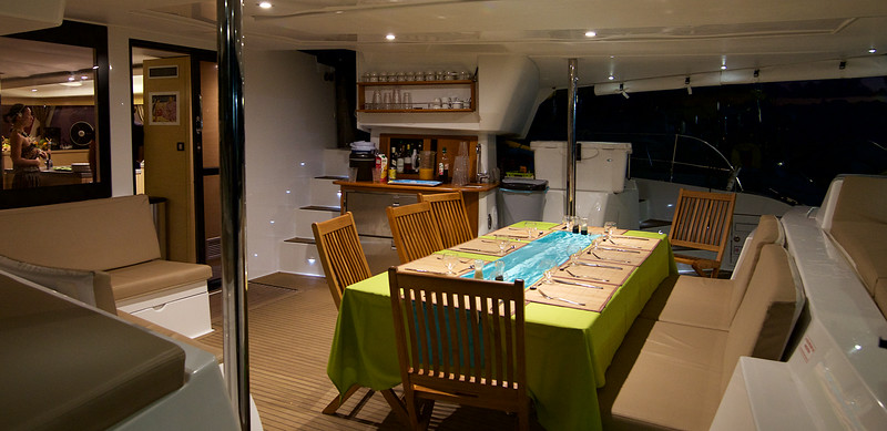 The afterdeck (and dining area) aboard Te Miti VIII, with the salon and fully-equipped galley through the door to the left.  I don't think we can be accused of roughing it!