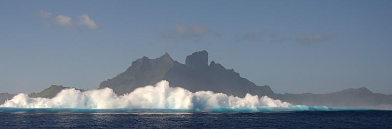 Surf breaking on the reef outside the Bora Bora lagoon