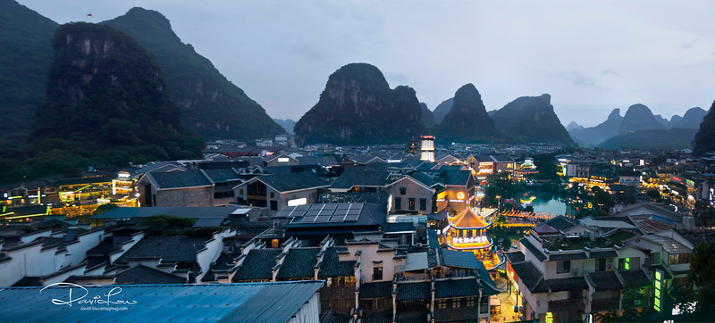 Yangshou city with endless of limestone mountains in the background (sunset)