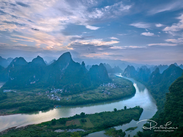 A cool sunrise in Yangshou - The magical mountains with Li River at foreground.