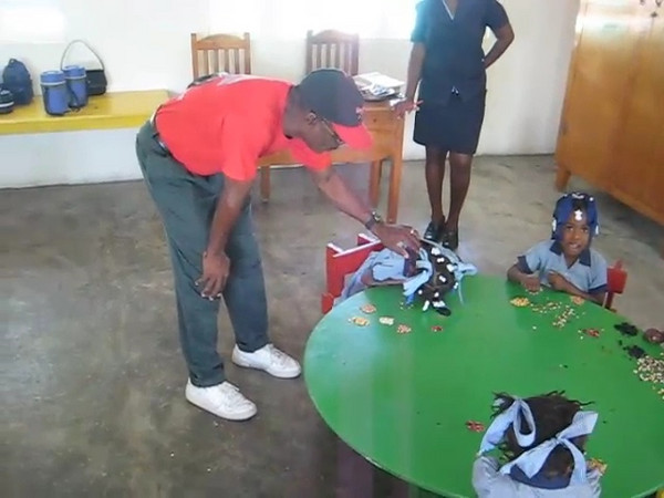 Leon De Orleans speaking to some kindergarteners at the school founded by him and his wife Jacky in Citi Soleil / Port au Prince.