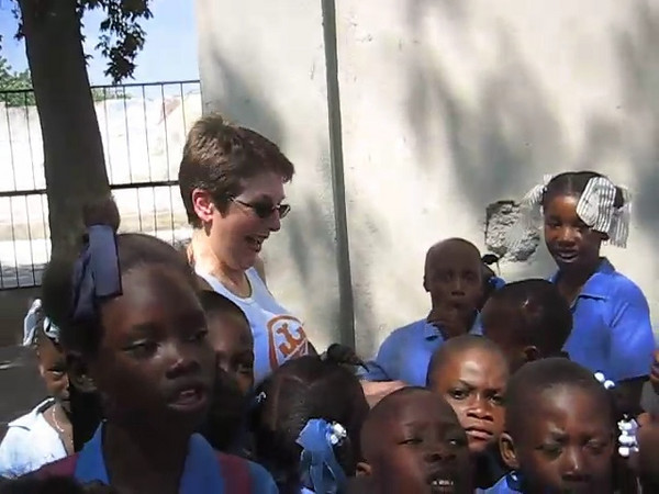 Carol Farnham at the Good Shepherd school in Pele, Port au Prince Haiti. The school was founded by Charlie and Mary Scott in 1982. Photo taken by Mary Scott.