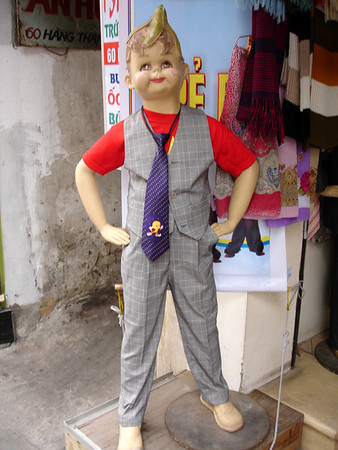 boy's clothing mannequin with banana on his head, Hanoi