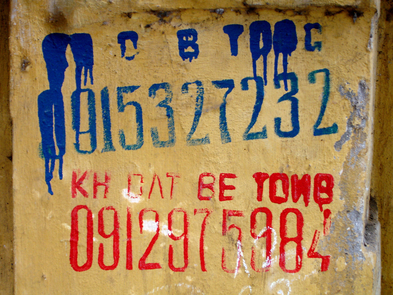 mobile number graffiti with day labor's name & number, Hanoi