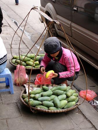 a mango vendor, Hanoi