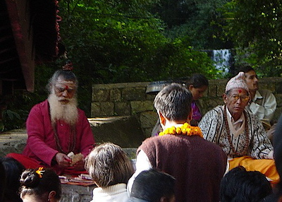 Holy men giving blessings at the Kali Temple, Kathmandu Valley, Nepal