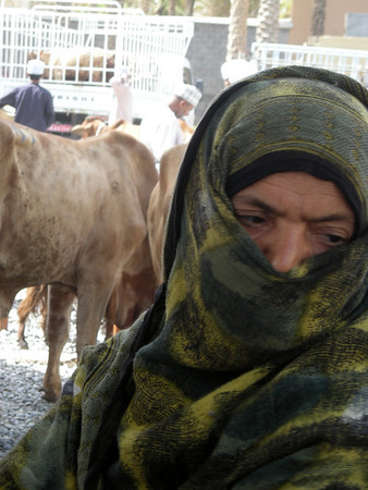 woman at the weekly animal market auction in Nizwa, Oman