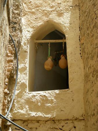 water jugs cooling in a window