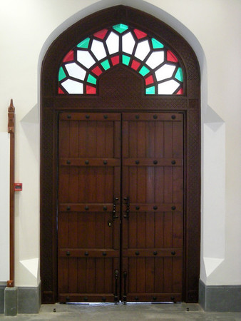 wooden door in the Muscat Gate Museum, Oman