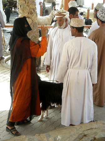 woman negotiating with her goat seller about bids received from potential buyers